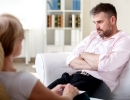 Addicted businessman on psychotherapy session